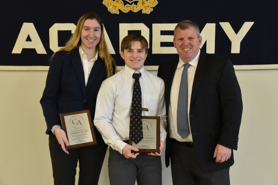 From left, basketball player Audrey Allen and fencer Thomas Craley posed with football head coach Dave Dykeman after receiving the Trustee Awards during the CA Winter Sports Awards Banquet. Photo courtesy of CA.