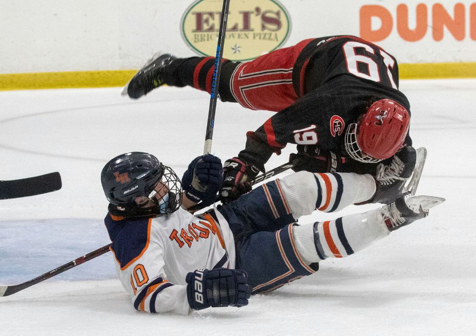 Lyman Hall junior Jack Roberts gets tangled up with Cheshire senior defenseman Michael Donato in the first period. Photo taken by Aaron Flaum/Record-Journal.