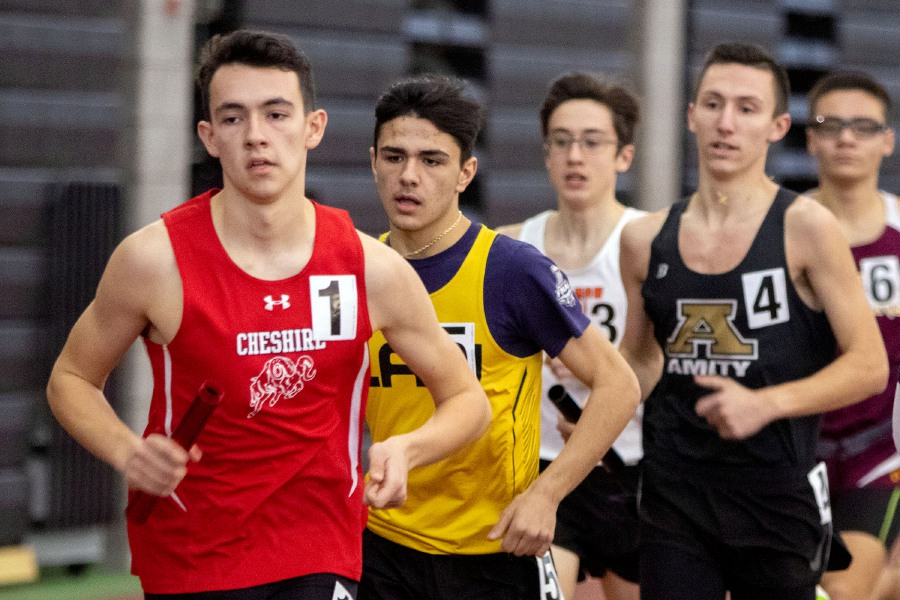 Cheshire's Brendan Mellitt leads the pack during the first leg of the 4x800 during the SCC Eastern Sectional at the Floyd Little Athletic Center in New Haven on Wednesday, January 29, 2020. The team finished first. Aaron Flaum, Record-Journal