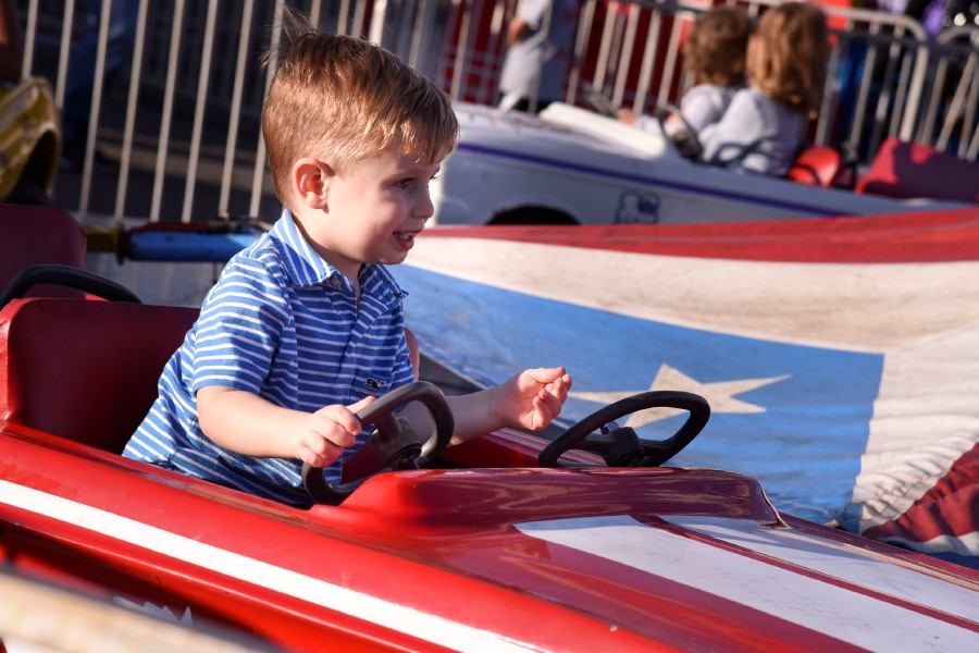 Louie Ferraro, 2, of Cheshire, on a carnival ride at the Cheshire Fall Festival on Friday, Sept. 13, 2019. | Bailey Wright, Record-Journal