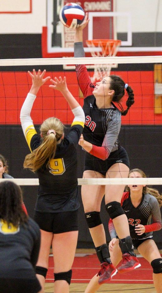 Lindsey Abramson goes up for a kill in the home opener against Amity. Photo taken by James Brandolini/Cheshire Herald.