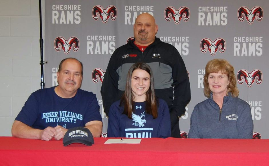 On Feb. 5, Olivia Santoro, seated between her father Mark and mother Ellen, was recognized for committing to play tennis at Roger Williams University. Cheshire girls