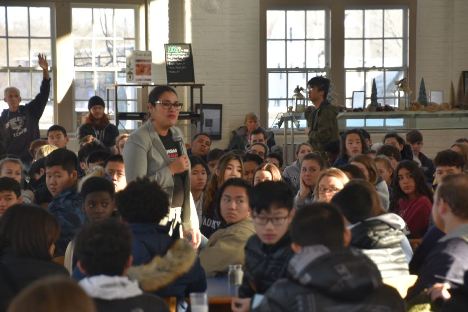Courtesy of Cheshire Academy – Dr. Maysa Akbar asks students questions about equality at the recent MLK Day celebration at Cheshire Academy.