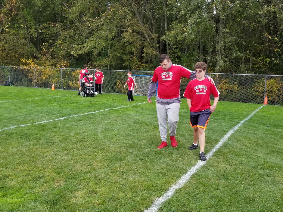 Submitted by Matt Guida. CHS Unified Sports teammates talk strategy during one of their activities in 2019.