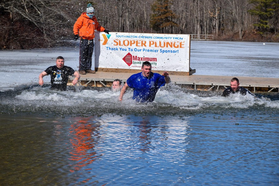 Participants make a splash during the 16th Annual Sloper Plunge. Photo courtesy of Southington-Cheshire Community YMCA.