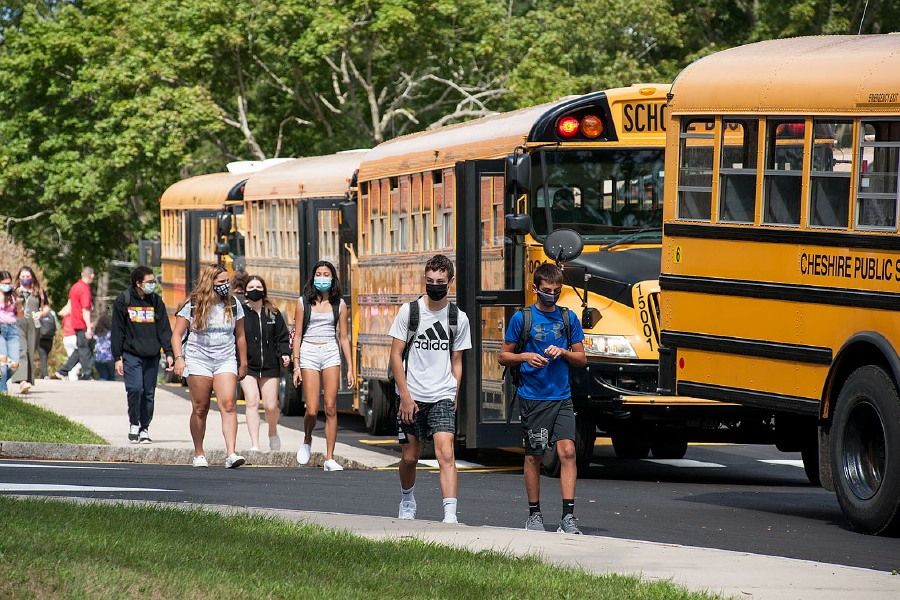 Al Valerio/Cheshire Herald - Students at Cheshire High School took the bus home from school on Sept. 11, for the first time since local school buildings closed on March 13 due to the pandemic.