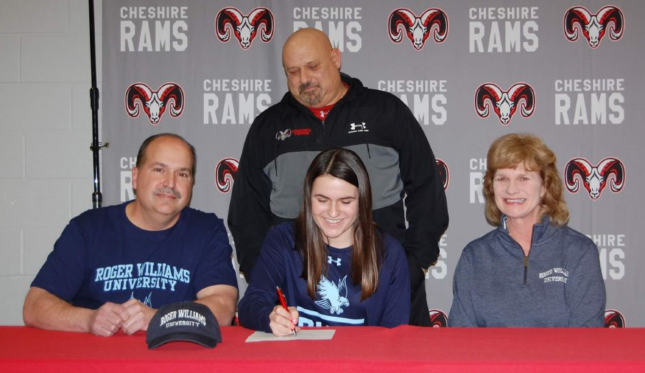 Olivia Santoro had fun during her college tennis event. Her father Mark and mother Ellen are pictured sitting with her. Cheshire Head Coach Bruce Levine is standing in the back. Photo taken by Greg Lederer/Cheshire Herald.