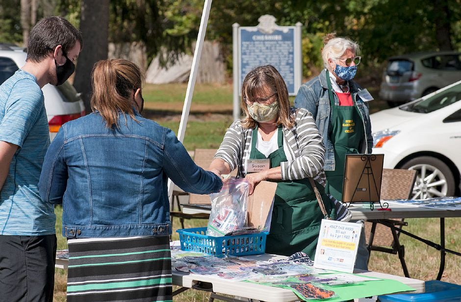 Al Valerio/Cheshire Herald - The Suburban Garden Club was busy making and then selling masks to those interested in keeping safe and giving back to the community on the green in front of First Congregational Church last October.