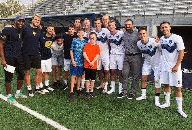Submitted photo – Sam and his brother Luke with the QU Mens Soccer Team