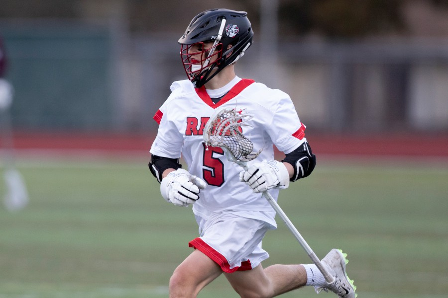 As a sophomore, PJ Cass tallied his first five varsity points (two goals, three assists) for CHS boys' lacrosse. Photo taken by James Brandolini/Cheshire Herald.