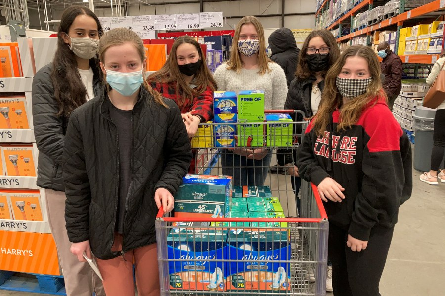 Pictured: Molly Bowman, Izzy Schackner, Lily Shaheen, Kaelyn Fitzgerald, Cam Lewis, and Brenna Zbikowski dropping off feminine hygine products they've collected through donations to the Cheshire Food Pantry.