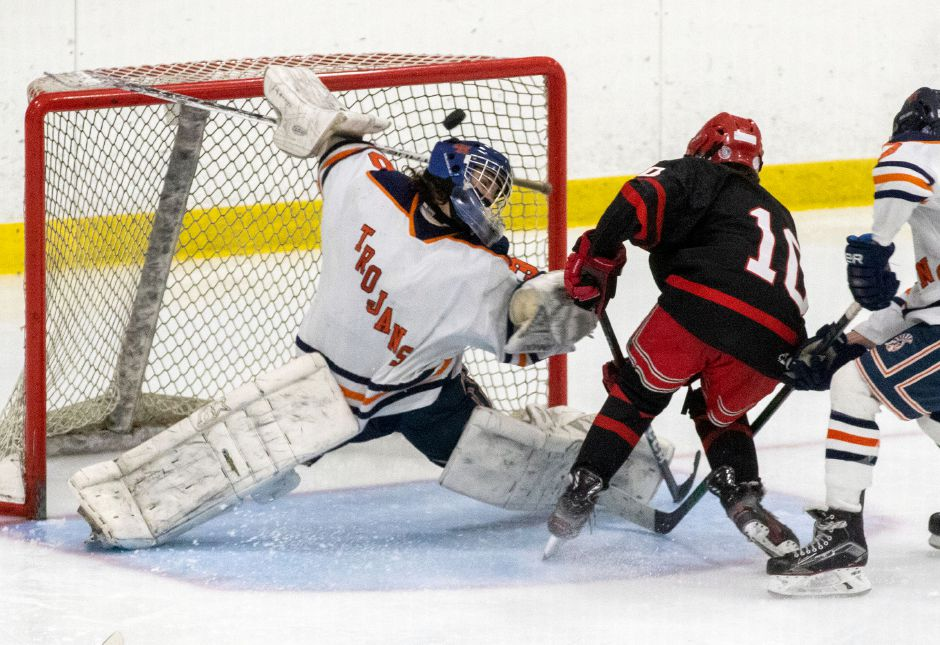 CHS sophomore Will Gaudet has a point-blank shot deflected over the net by Lyman Hall senior goalkeeper Brendan Reddington. Photo taken by Aaron Flaum/Record-Journal.