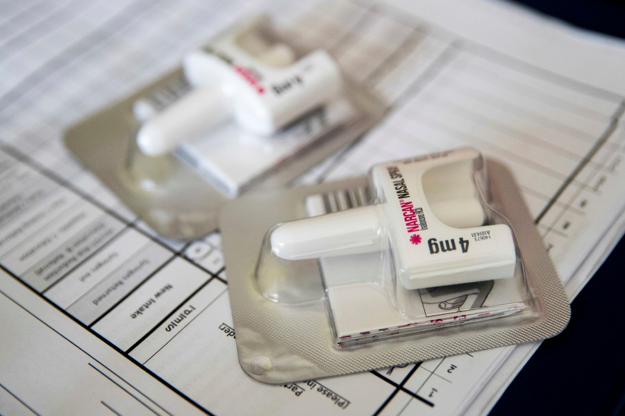 AP Photo/Mary Altaffer – A Narcan nasal device is used to help those who have overdosed on certain opioids.
