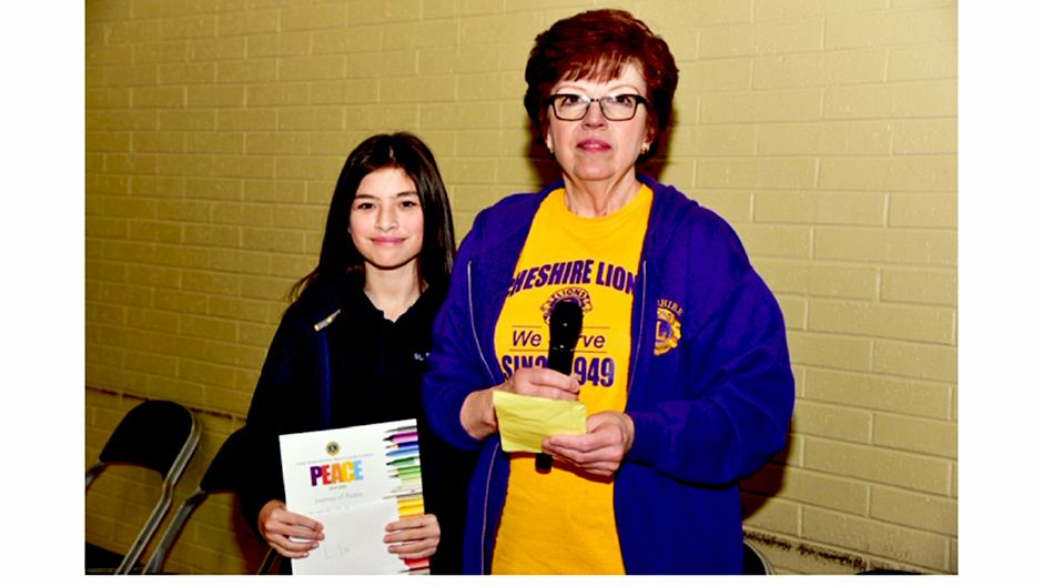 Photo courtesy of Anthony Cipriano - Lila Kiernan (left) was presented a certificate by Lions Club Secretary Nancy DeFrancesco for having placed first in this year