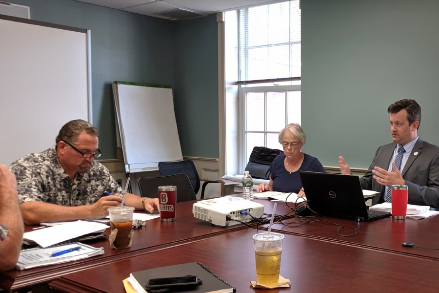 The Town Council, along with Town Manager Sean M. Kimball (right), performing a review of the Cheshire operating budget during deliberations in 2019.