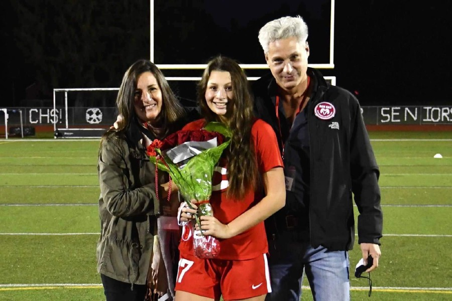 Before playing in her final CHS soccer home game on Nov. 9 of last year, Izzy Pellegrino was honored on Senior Night. Pellegrino is pictured with her mother Sandra and father Enzo. Submitted photo.