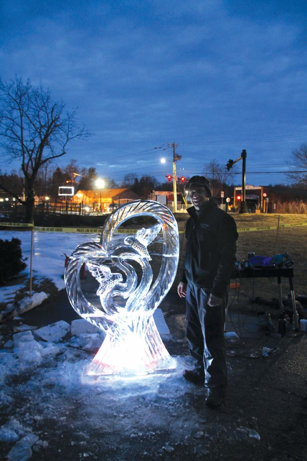Tracey Harrington/Cheshire Herald - Ball & Socket Arts continues to pursue its dream of turning the old factory on West Main Street into a arts and cultural hub. In February, they held a Fire & Ice fundraiser where Bill Covitz of Ice Matters created his sculpture for all to enjoy.