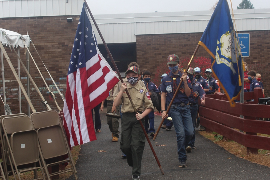 Mariah Melendez/Cheshire Herald- Highland Boy Scouts lead the walking parade at Highland Elementary School for Veterans Day.