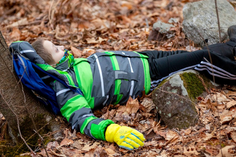 Zane Kowalski 7, looks up to the branches as he lies under a tree during a Fit by Nature class as he tries shinrin-yoku or forest bathing at Mixville Park in Cheshire on Monday, January 11, 2021. Aaron Flaum, Record-Journal.com